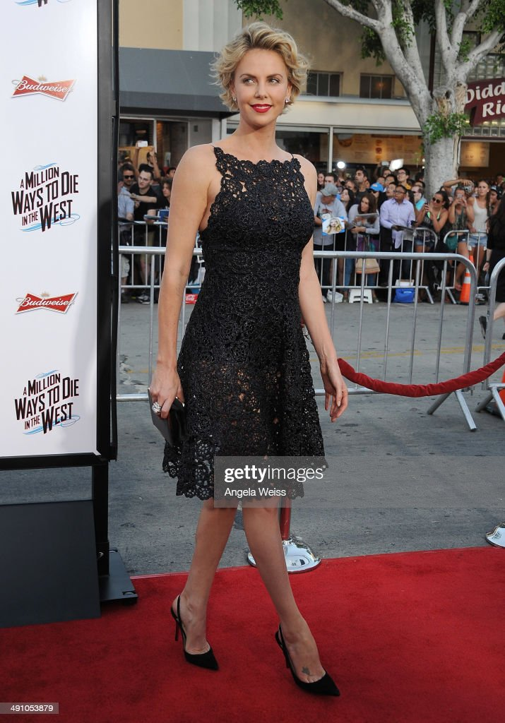 Actress <a gi-track='captionPersonalityLinkClicked' href=/galleries/search?phrase=Charlize+Theron&family=editorial&specificpeople=171250 ng-click='$event.stopPropagation()'>Charlize Theron</a> attends the premiere of 'A Million Ways To Die In The West' presented by Budweiser at Regency Village Theatre on May 15, 2014 in Los Angeles, California.