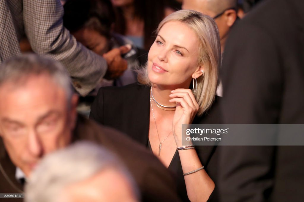 Actress Charlize Theron attends the super welterweight boxing match between Floyd Mayweather Jr. and Conor McGregor on August 26, 2017 at T-Mobile Arena in Las Vegas, Nevada.