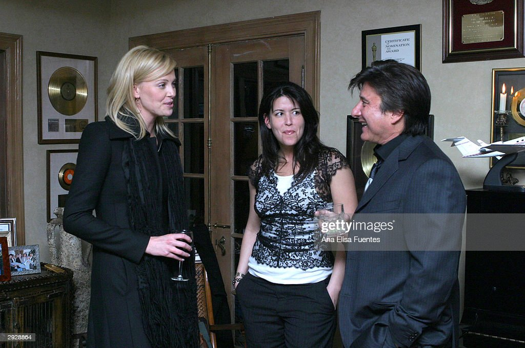 Actress <a gi-track='captionPersonalityLinkClicked' href=/galleries/search?phrase=Charlize+Theron&family=editorial&specificpeople=171250 ng-click='$event.stopPropagation()'>Charlize Theron</a>, director/writer Patty Jenkins and musician Steve Perry socialize as they attend the <a gi-track='captionPersonalityLinkClicked' href=/galleries/search?phrase=Charlize+Theron&family=editorial&specificpeople=171250 ng-click='$event.stopPropagation()'>Charlize Theron</a> tribute reception during the 2004 Santa Barbara International Film Festival February 3, 2004 in Santa Barbara, California.