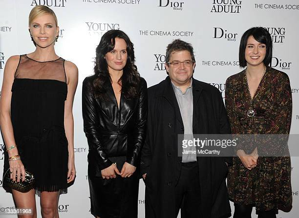 Actress Charlize Theron Elizabeth Reaser Patton Oswalt and Anson Mount attend the Cinema Society Dior Beauty screening of 'Young Adult' at the...