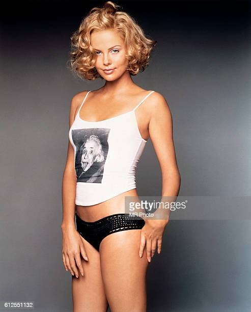 Charlize Theron wears a white tank top with an image of Albert Einstein sticking out his tongue