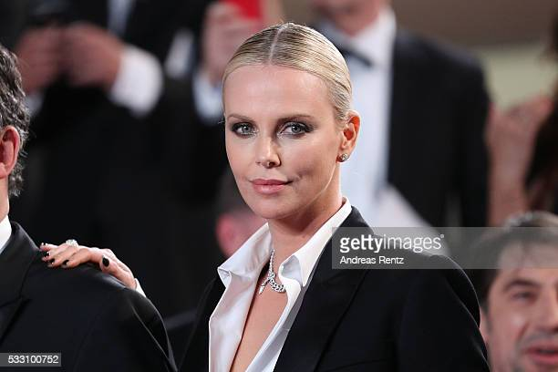 Actress Charlize Theron leaves 'The Last Face' Premiere during the 69th annual Cannes Film Festival at the Palais des Festivals on May 20 2016 in...