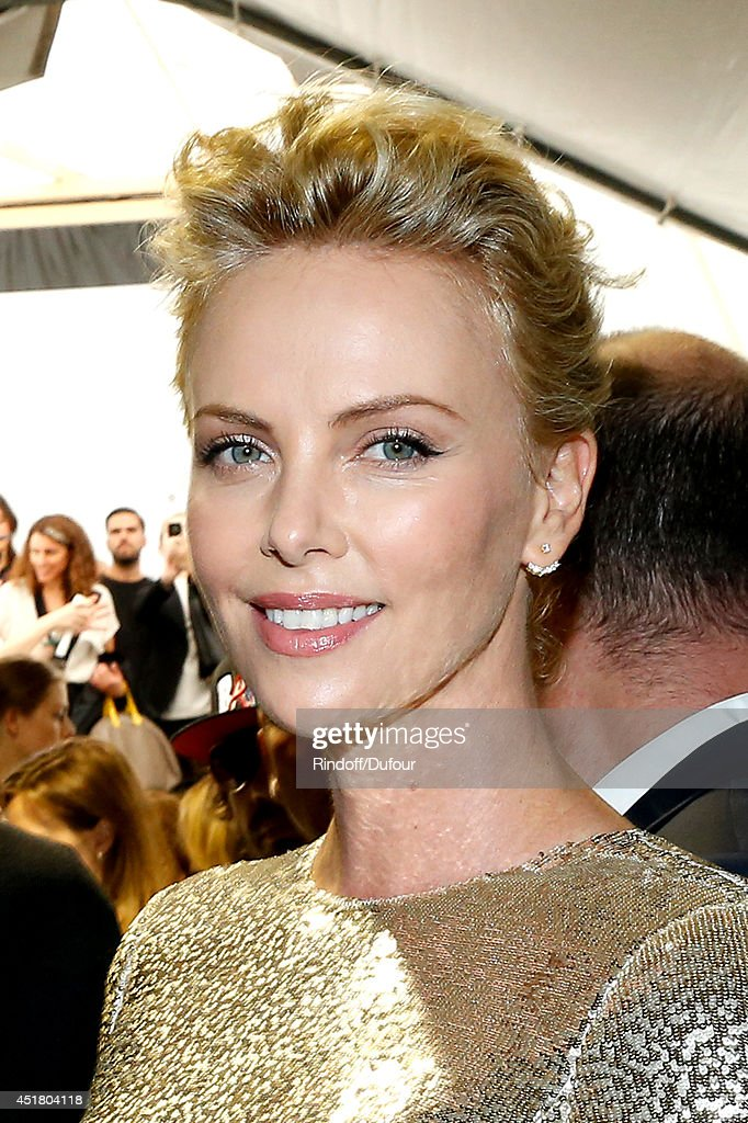 Actress <a gi-track='captionPersonalityLinkClicked' href=/galleries/search?phrase=Charlize+Theron&family=editorial&specificpeople=171250 ng-click='$event.stopPropagation()'>Charlize Theron</a> poses backstage after the Christian Dior show as part of Paris Fashion Week - Haute Couture Fall/Winter 2014-2015. Held at Musee Rodin on July 7, 2014 in Paris, France.