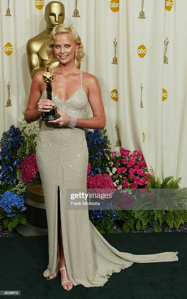 Actress <a gi-track='captionPersonalityLinkClicked' href=/galleries/search?phrase=Charlize+Theron&family=editorial&specificpeople=171250 ng-click='$event.stopPropagation()'>Charlize Theron</a> poses backstage with her Oscar after winning Best Female Actress for 'Monster' during the 76th Annual Academy Awards at the Kodak Theater on February 29, 2004 in Hollywood, California.