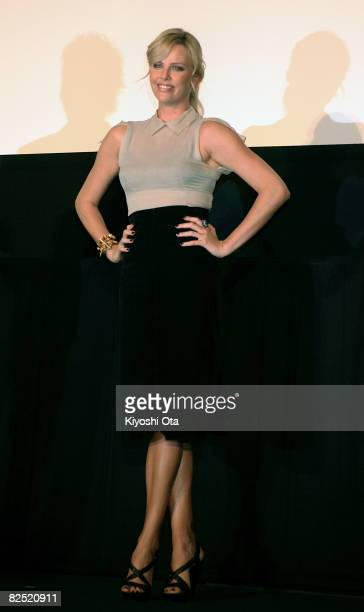 Actress Charlize Theron poses for photographers during the 'Hancock' Stage Greeting at Shinjuku Piccadilly on August 23 2008 in Tokyo Japan The film...