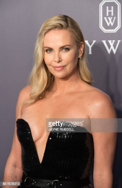 Actress Charlize Theron poses on the red carpet during the 2017 American Foundation for AIDS Research Hong Kong gala at Shaw Studios in Hong Kong on...