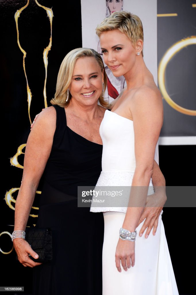 Actress <a gi-track='captionPersonalityLinkClicked' href=/galleries/search?phrase=Charlize+Theron&family=editorial&specificpeople=171250 ng-click='$event.stopPropagation()'>Charlize Theron</a> (R) poses with her mother Gerda Maritz at the Oscars at Hollywood & Highland Center on February 24, 2013 in Hollywood, California.