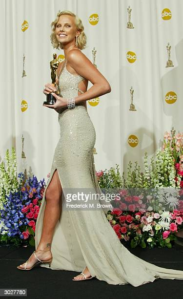 Actress Charlize Theron poses with her Oscar for Best Performance by an Actress in a Leading Role during the 76th Annual Academy Awards at the Kodak...