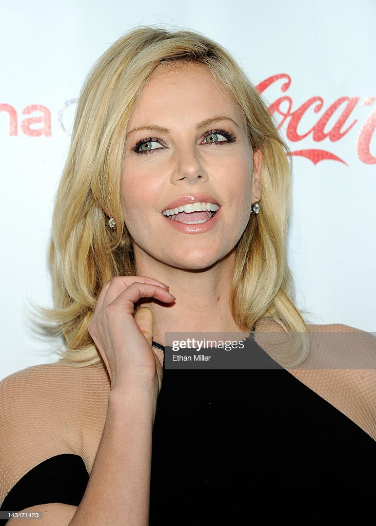 Actress <a gi-track='captionPersonalityLinkClicked' href=/galleries/search?phrase=Charlize+Theron&family=editorial&specificpeople=171250 ng-click='$event.stopPropagation()'>Charlize Theron</a>, recipient of the Distinguished Decade of Achievement in Film Award, arrives at the CinemaCon awards ceremony at the Pure Nightclub at Caesars Palace during CinemaCon, the official convention of the National Association of Theatre Owners, April 26, 2012 in Las Vegas, Nevada.