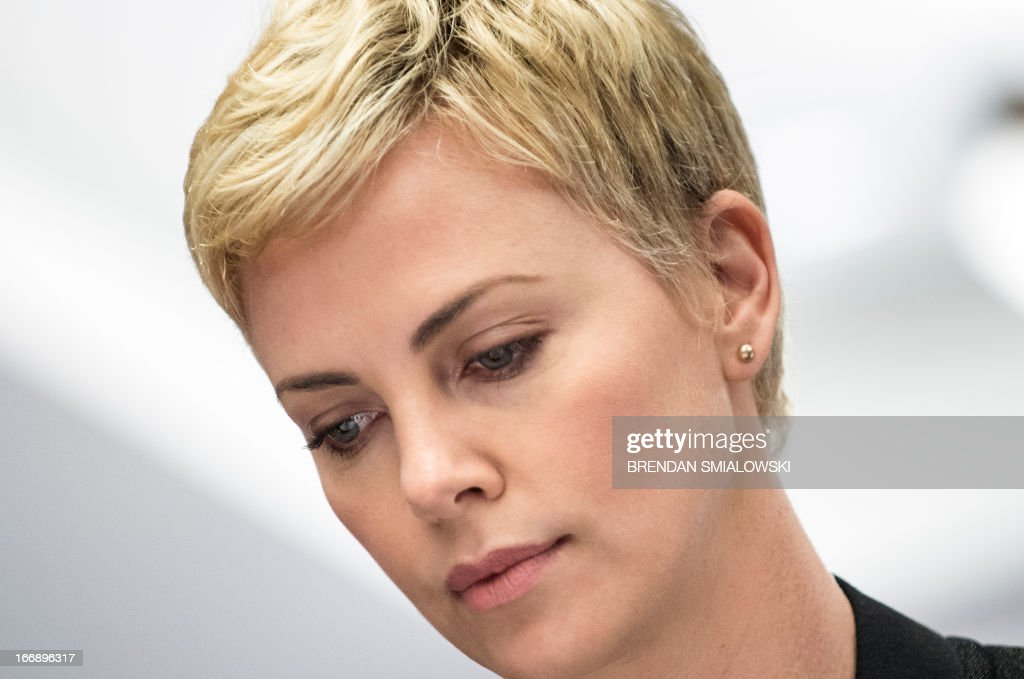Actress Charlize Theron waits for an event to begin on Capitol hill April 18, 2013 in Washington, DC. Theron, who is the founder of the Africa Outreach Project, attended the event with UNAIDS Executive Director Michel Sidibe and South African Minister of Finance Pravin Jamnadas Gordhan to speak about fighting the AIDS epidemic. AFP PHOTO/Brendan SMIALOWSKI