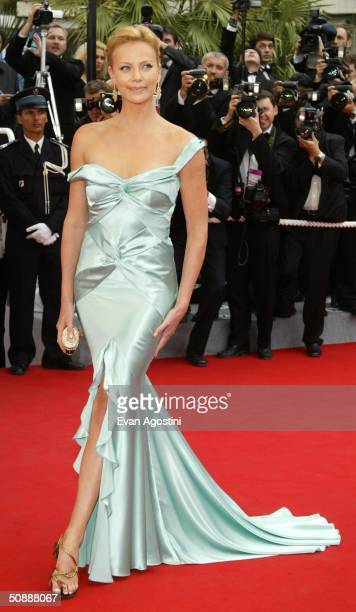 Actress Charlize Theron wearing Chopard jewelry arrives to the closing night ceremony and the screening of 'DeLovely' during the 57th Cannes Film...