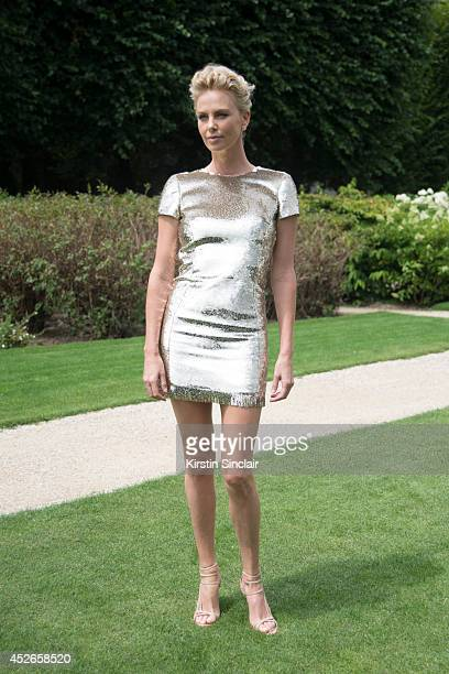 Actress Charlize Theron wearing Dior day 2 of Paris Haute Couture Fashion Week Autumn/Winter 2014 on July 7 2014 in Paris France