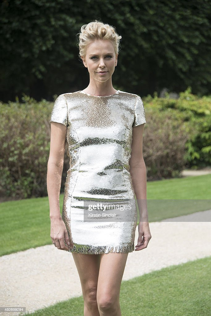 Actress <a gi-track='captionPersonalityLinkClicked' href=/galleries/search?phrase=Charlize+Theron&family=editorial&specificpeople=171250 ng-click='$event.stopPropagation()'>Charlize Theron</a> wearing Dior day 2 of Paris Haute Couture Fashion Week Autumn/Winter 2014, on July 7, 2014 in Paris, France.