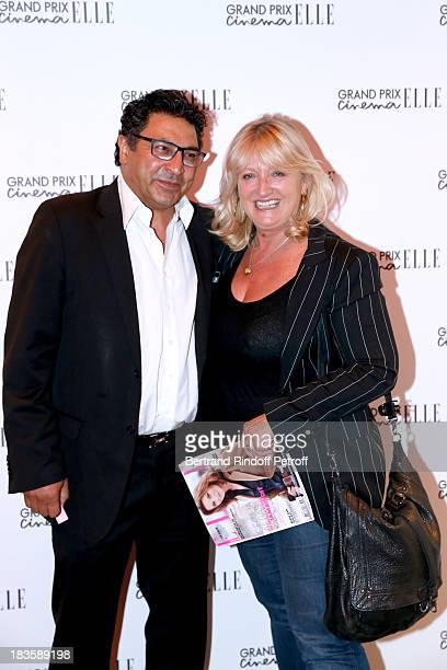 Actress Charlotte de Turckheim and her husband Zaman Hachemi attend 'Grand Prix Elle Cinema 2013' held at Cinema Gaumont ChampsElysees Marignan on...