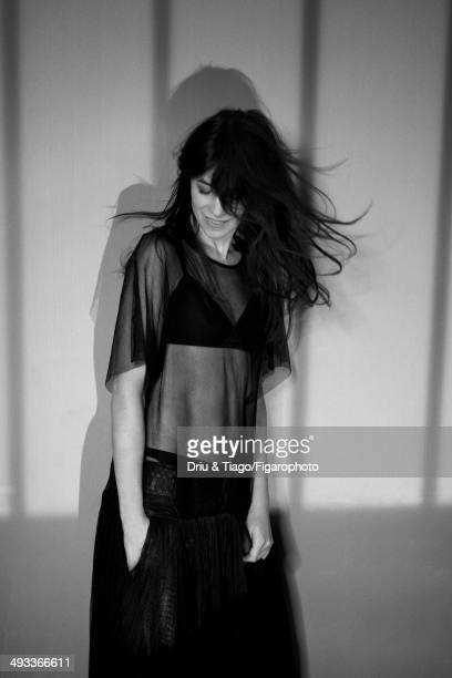 109160006 Actress Charlotte Gainsbourg is photographed for Madame Figaro on April 5 2014 in Paris France Dress and shorts bra Makeup by Dior...