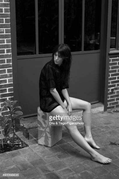 109160010 Actress Charlotte Gainsbourg is photographed for Madame Figaro on April 5 2014 in Paris France Tshirt and bra panties Makeup by Dior CREDIT...