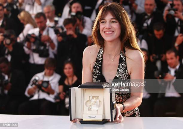 Actress Charlotte Gainsbourg poses with her Best Actress award during the Palm d'Or Award Ceremony Photocall at the Palais De Festivals during the...