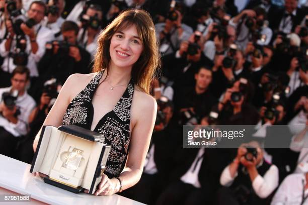 Actress Charlotte Gainsbourg poses with her Best Actress award for 'Antichrist' as she attends the Palme d'Or Award Ceremony Photocall at the Palais...