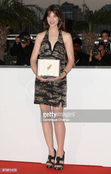 Actress Charlotte Gainsbourg with her Best Actress award for 'Antichrist' as she attends the Palme d'Or Award Ceremony Photocall at the Palais des...