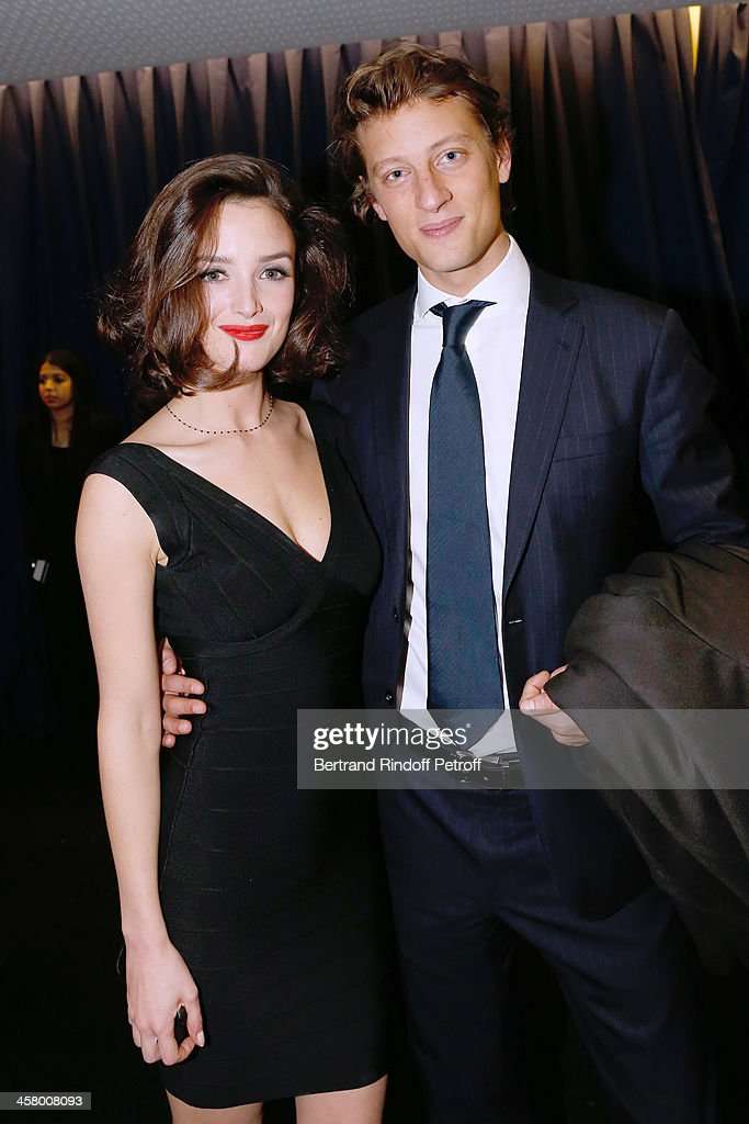 Actress <a gi-track='captionPersonalityLinkClicked' href=/galleries/search?phrase=Charlotte+Le+Bon&family=editorial&specificpeople=7162691 ng-click='$event.stopPropagation()'>Charlotte Le Bon</a> and Arthur de Villepin attend the 'Yves Saint Laurent' Paris movie Premiere at Cinema UGC Normandie on December 19, 2013 in Paris, France.