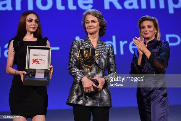 Actress Charlotte Rampling receives the Coppa Volpi for Best Actress Award for 'Hannah' from 'Venezia 74' jury member Jasmine Trinca and a...