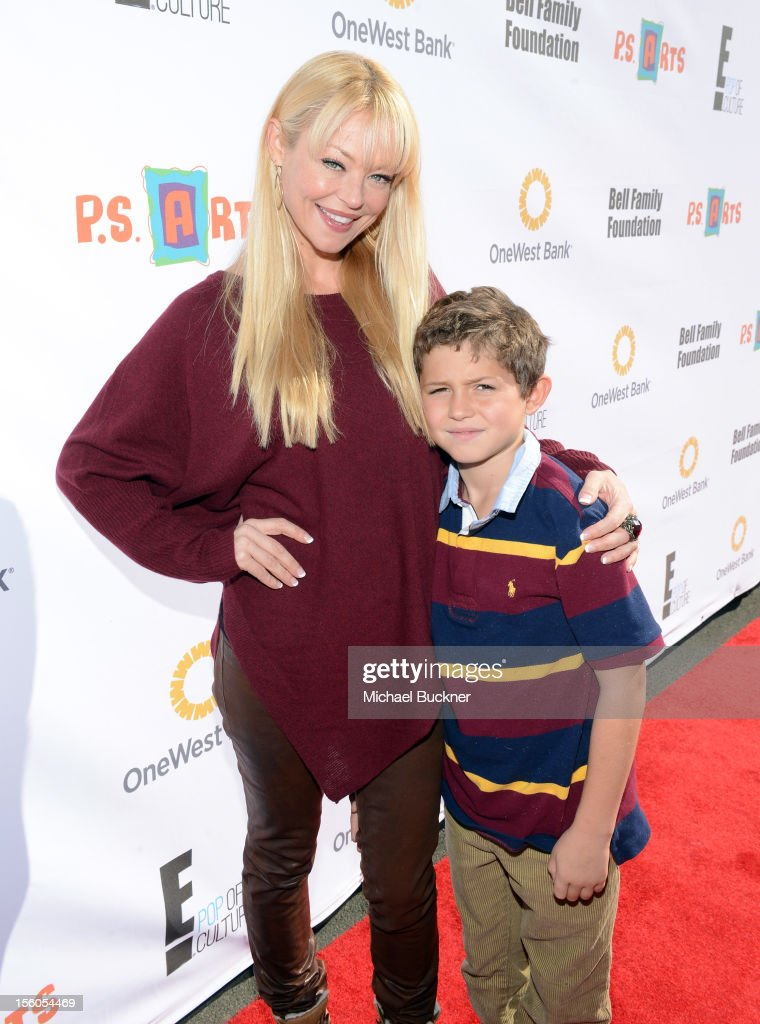 Actress <a gi-track='captionPersonalityLinkClicked' href=/galleries/search?phrase=Charlotte+Ross+-+Actress&family=editorial&specificpeople=217600 ng-click='$event.stopPropagation()'>Charlotte Ross</a> (L) and her son Max Goldman attend the creative arts fair and family day 'Express Yourself', supporting P.S. ARTS, at Barker Hangar on November 11, 2012 in Santa Monica, California.