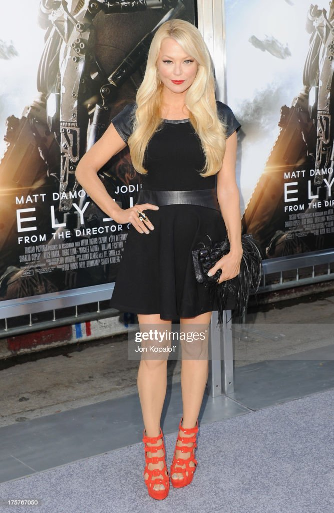 Actress <a gi-track='captionPersonalityLinkClicked' href=/galleries/search?phrase=Charlotte+Ross&family=editorial&specificpeople=217600 ng-click='$event.stopPropagation()'>Charlotte Ross</a> arrives at the Los Angeles Premiere 'Elysium' at Regency Village Theatre on August 7, 2013 in Westwood, California.