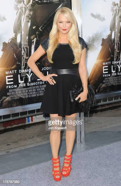 Actress Charlotte Ross arrives at the Los Angeles Premiere 'Elysium' at Regency Village Theatre on August 7 2013 in Westwood California