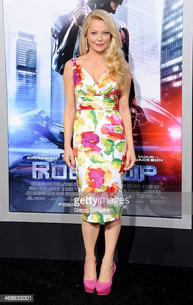 Actress Charlotte Ross arrives at the Los Angeles premiere of 'Robocop' at TCL Chinese Theatre on February 10 2014 in Hollywood California