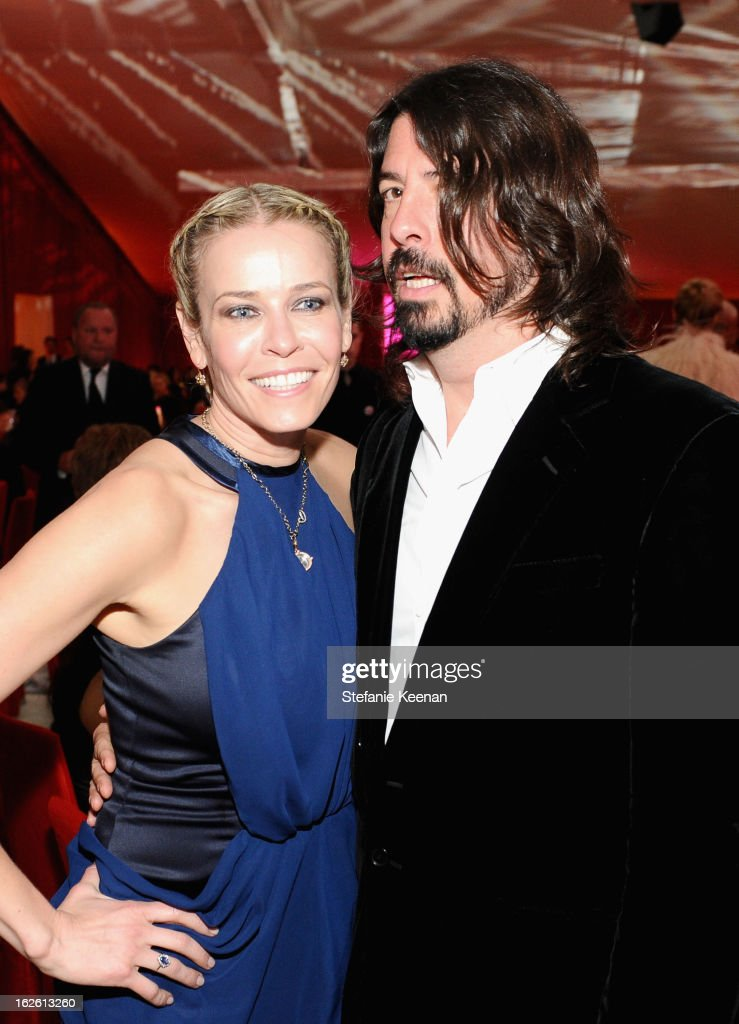 Actress Chelsea Handler and Dave Grohl attend Chopard at 21st Annual Elton John AIDS Foundation Academy Awards Viewing Party at West Hollywood Park on February 24, 2013 in West Hollywood, California.