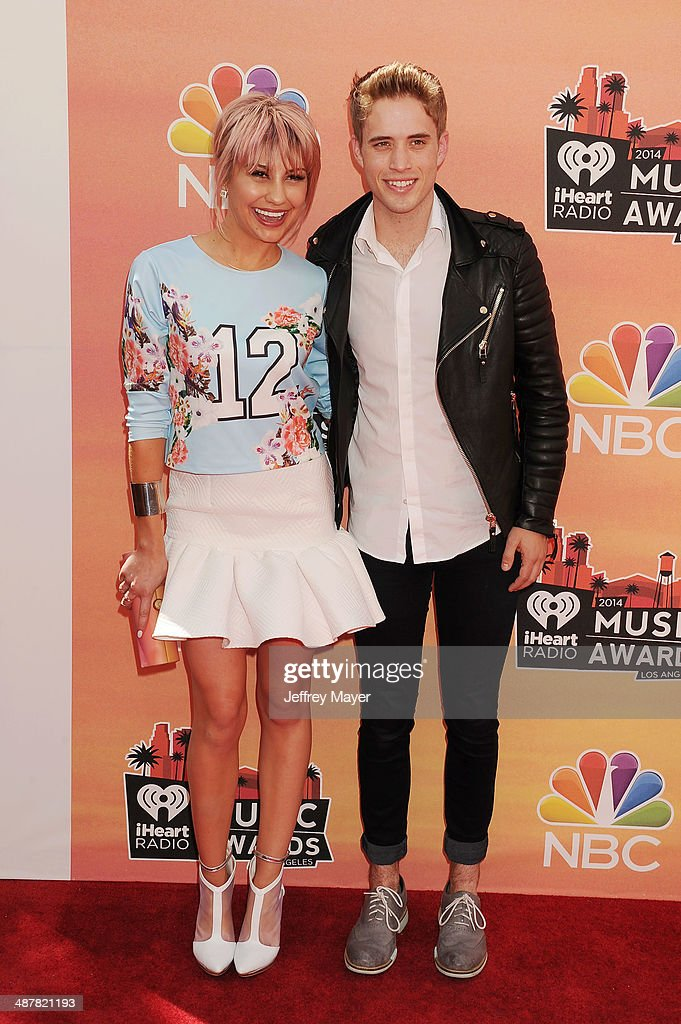 Actress Chelsea Kane (L) and singer/songwriter Brian Logan Dales attend the 2014 iHeartRadio Music Awards held at The Shrine Auditorium on May 1, 2014 in Los Angeles, California.