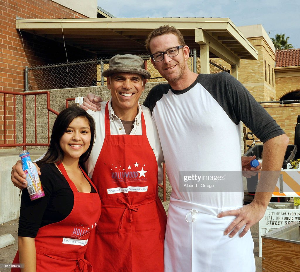 Actress Chelsea Rendon, actor Greg Collins and chef C.J. Jacobsen participate in the Hollywood Chamber of Commerce's annual police and firefighters appreciation day at the Hollywood LAPD station on November 28, 2012 in Hollywood, California.