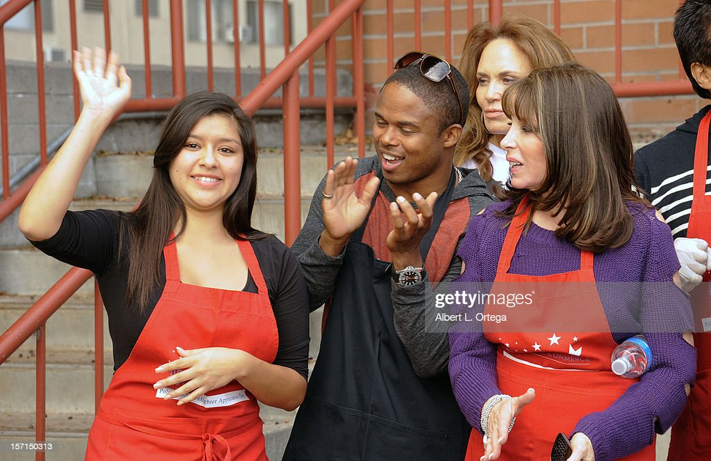 Actress Chelsea Rendon, actor Walter Jones, actress Catherine Bach and actress Kate Linder participate in the Hollywood Chamber of Commerce's annual police and firefighters appreciation day at the Hollywood LAPD station on November 28, 2012 in Hollywood, California.