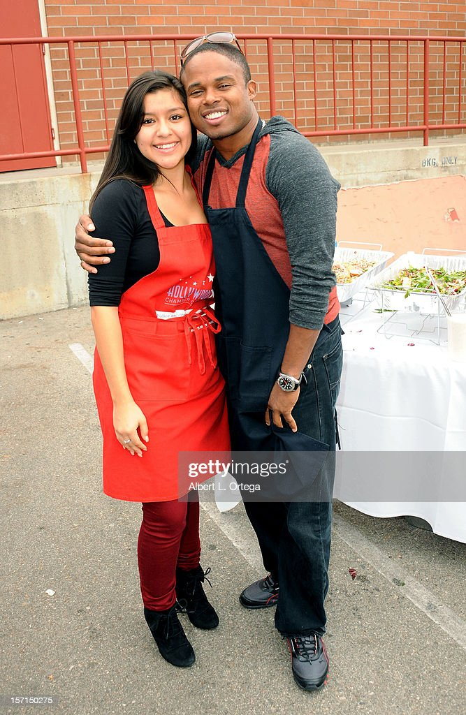 Actress Chelsea Rendon and actor Walter Jones participate in the Hollywood Chamber of Commerce's annual police and firefighters appreciation day at the Hollywood LAPD station on November 28, 2012 in Hollywood, California.