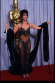 Actress Cher holds her Best Actress in a Leading Role Oscar for 'Moonstruck' at the Academy Awards April 11 1988 in Los Angeles CA The Academy Awards...