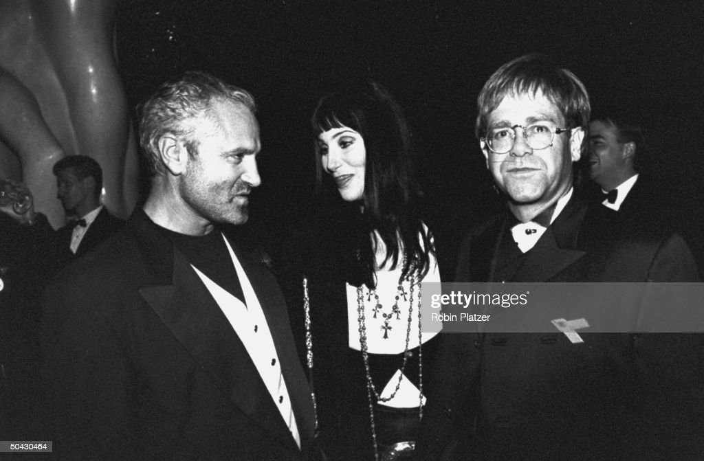 Actress Cher schmoozing w singer Elton John fashion designer Gianni Versace at the 12th annual Council of Fashion Designers of America Awards...