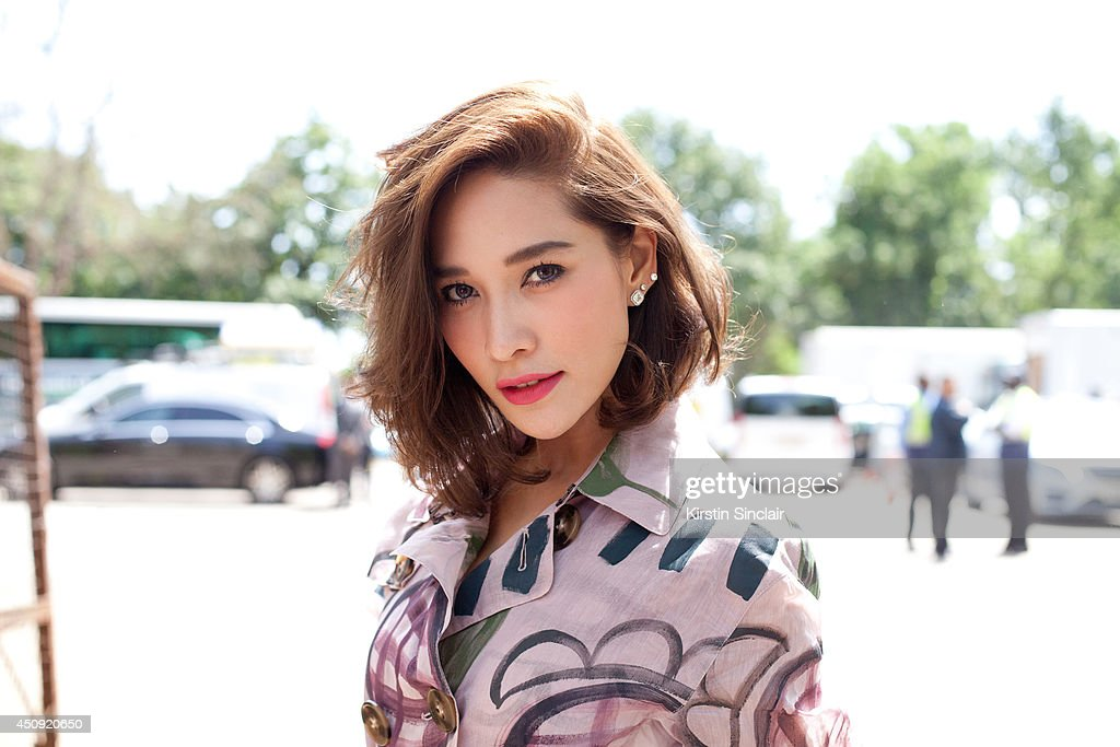 Actress Cherman Boonyasak wears And Other Stories shirt and Burberry dress on day 3 of London Collections: Men on June 17, 2014 in London, England.