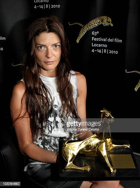 Actress Chiara Mastroianni poses with the Excellence Award Moet Chandon during the 63rd Locarno Film Festival on August 6 2010 in Locarno Switzerland