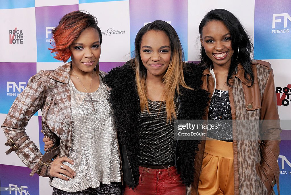 Actress China Anne McClain (C) and sisters arrive at The Grammy Awards: Friends 'N' Family party at Paramount Studios on February 8, 2013 in Hollywood, California.
