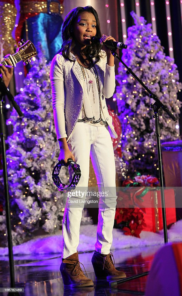 Actress China Anne McClain of the McClain Sisters performs on stage at Associated Television International's 2012 Hollywood Christmas Parade Concert at Universal CityWalk's 5 Towers on November 20, 2012 in Universal City, California.