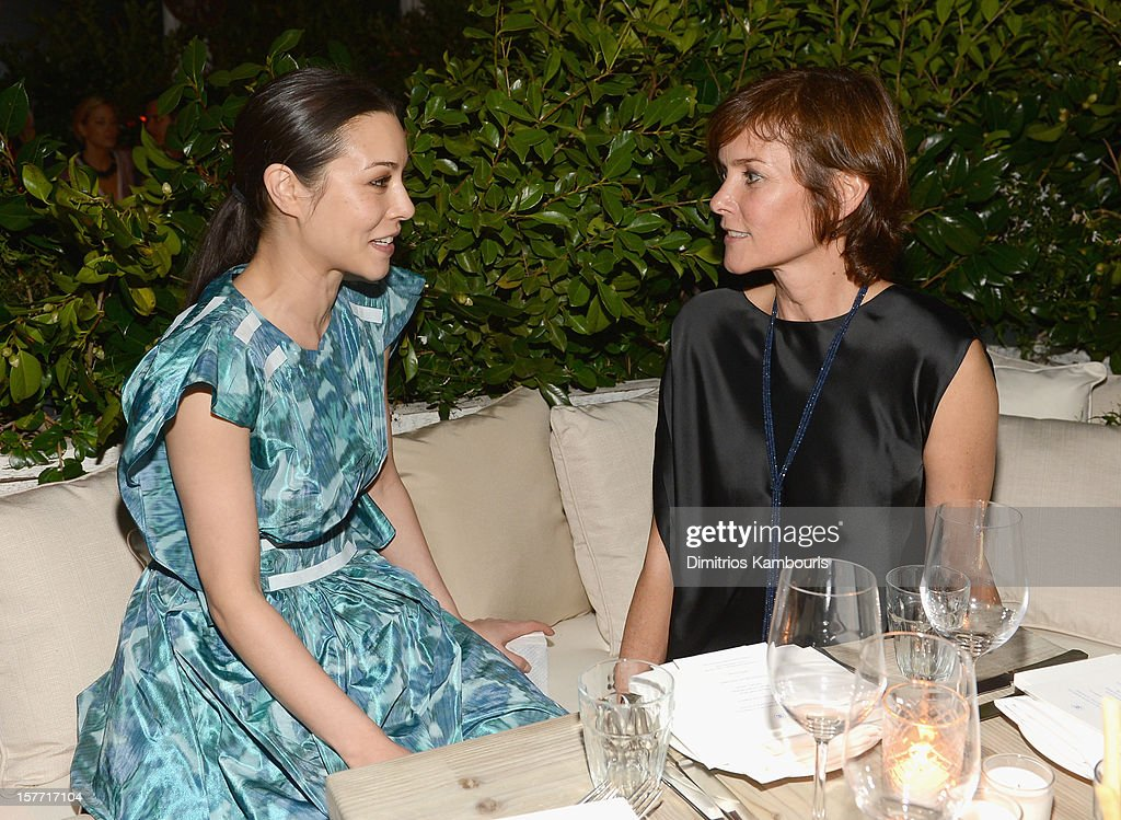 Actress China Chow and Carey Lowell attend a dinner and auction hosted by CHANEL to benefit the Henry Street Settlement at Soho Beach House on December 5, 2012 in Miami Beach, Florida.