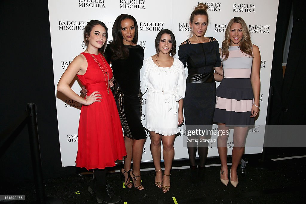 Actress <a gi-track='captionPersonalityLinkClicked' href=/galleries/search?phrase=Chloe+Bridges&family=editorial&specificpeople=5498869 ng-click='$event.stopPropagation()'>Chloe Bridges</a>, model <a gi-track='captionPersonalityLinkClicked' href=/galleries/search?phrase=Selita+Ebanks&family=editorial&specificpeople=619483 ng-click='$event.stopPropagation()'>Selita Ebanks</a>, gymnast <a gi-track='captionPersonalityLinkClicked' href=/galleries/search?phrase=Alexandra+Raisman&family=editorial&specificpeople=7138858 ng-click='$event.stopPropagation()'>Alexandra Raisman</a>, <a gi-track='captionPersonalityLinkClicked' href=/galleries/search?phrase=Petra+Nemcova&family=editorial&specificpeople=201716 ng-click='$event.stopPropagation()'>Petra Nemcova</a>, and singer <a gi-track='captionPersonalityLinkClicked' href=/galleries/search?phrase=Colbie+Caillat&family=editorial&specificpeople=4410812 ng-click='$event.stopPropagation()'>Colbie Caillat</a> pose backstage at the Badgley Mischka Fall 2013 fashion show during Mercedes-Benz Fashion Week at The Theatre at Lincoln Center on February 12, 2013 in New York City.