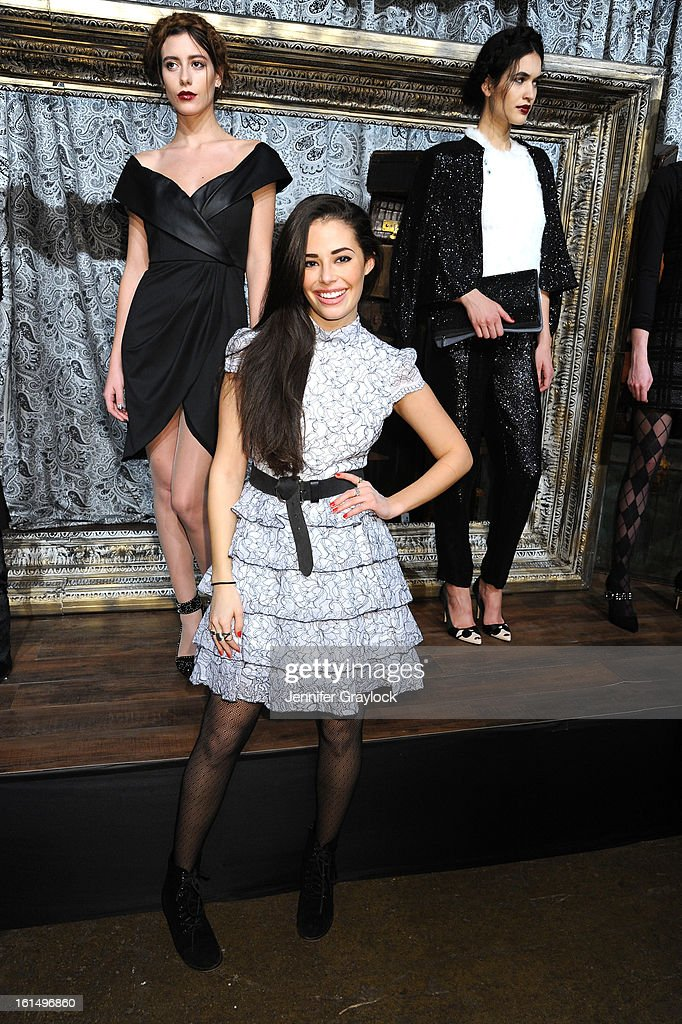 Actress <a gi-track='captionPersonalityLinkClicked' href=/galleries/search?phrase=Chloe+Bridges&family=editorial&specificpeople=5498869 ng-click='$event.stopPropagation()'>Chloe Bridges</a> poses at the Alice + Olivia By Stacey Bendet Fall 2013 fashion show presentation during Mercedes-Benz Fashion Week at Highline Stages on February 11, 2013 in New York City.