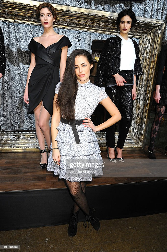 Actress Chloe Bridges poses at the Alice + Olivia By Stacey Bendet Fall 2013 fashion show presentation during Mercedes-Benz Fashion Week at Highline Stages on February 11, 2013 in New York City.
