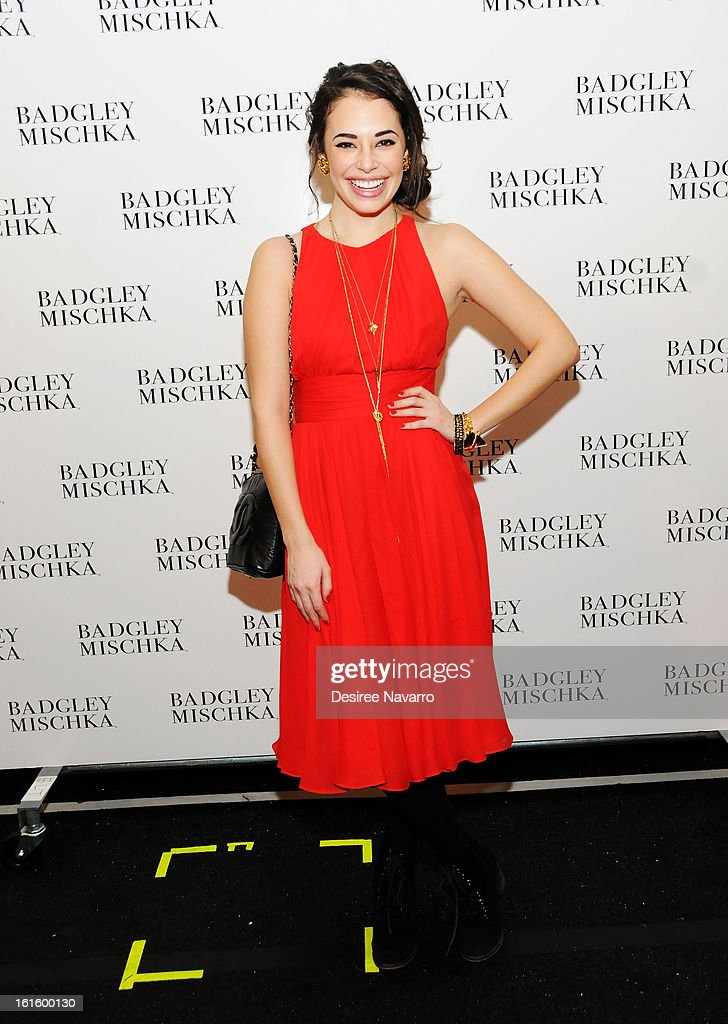 Actress Chloe Bridges poses backstage for photo at Badgley Mischka during Fall 2013 Mercedes-Benz Fashion Week at The Theatre at Lincoln Center on February 12, 2013 in New York City.