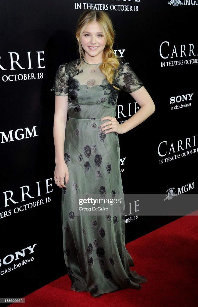 Actress Chloe Grace Moretz arrives at the Los Angeles premiere of 'Carrie' at ArcLight Hollywood on October 7, 2013 in Hollywood, California.