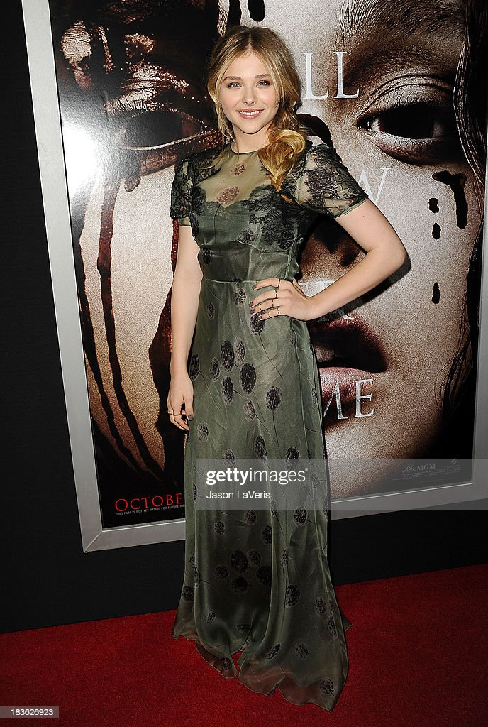 Actress Chloe Grace Moretz attends the premiere of 'Carrie' at ArcLight Hollywood on October 7, 2013 in Hollywood, California.