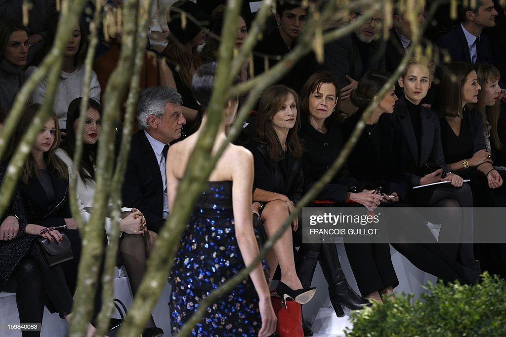 US actress Chloe Grace Moretz, French actress Laetitia Casta, Christian Dior CEO Sidney Toledano, French actress Isabelle Huppert, US actresses Sigourney Weaver, Jessica Alba and Leelee Sobieski, French actress Carole Bouquet and French jewellery designer Victoire de Castellane attend the Christian Dior Haute Couture Spring-Summer 2013 collection show by Belgian designer Raf Simons on January 21, 2013 in Paris.