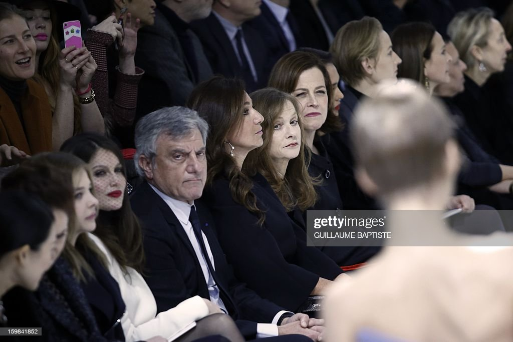 US actress Chloe Grace Moretz, French actress Laetitia Casta, Christian Dior CEO Sidney Toledano and his wife Katia, French actress Isabelle Huppert, US actresses Sigourney Weaver, Jessica Alba and Leelee Sobieski, French actress Carole Bouquet and Tunisian-born Azzedine Alaia attend the Christian Dior Haute Couture Spring-Summer 2013 collection show by Belgian designer Raf Simons on January 21, 2013 in Paris.