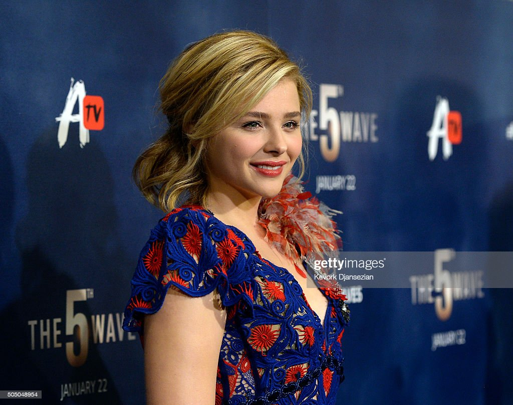 Actress Chloe Grace Moretz poses during the AwesomenessTV special fan screening of 'The 5th Wave' at Pacific Theatre at The Grove January 14, 2016 in Los Angeles California.